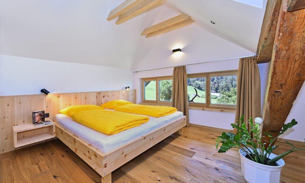 Casa vacanza con arredi in legno nell'agriturismo biologico in Alto Adige